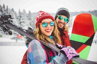 Guy and girl snowboard excess baggage Canada